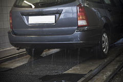 Clean vehicle in car wash. Closeup of rear part of clean vehicle in car wash royalty free stock photo