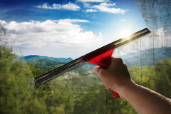 Clean View. Person cleans a dirty window Royalty Free Stock Image