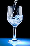 Clean water. A Glass of clean water on black background Royalty Free Stock Photography