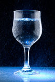 Clean water. A Glass of clean water on black background Royalty Free Stock Image