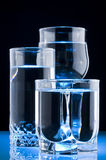 Clean water. Three glass of clean water on black background Royalty Free Stock Images