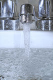 Clean water. Cold fresh water gushing out of the tap Stock Image