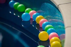 Clean water in the blue pool with colorful balls, background. Water in the blue pool with colorful balls with reflection, background Royalty Free Stock Photos