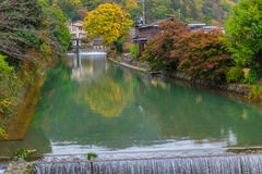 Clean water canal in Japan with beautiful nature green tree landscape stock photography