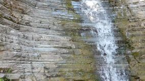 Clean water fall from old rocks - waterfall on stone wall stock footage