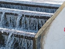 Clean water flowing on a distribution tank. For water works systems royalty free stock photo