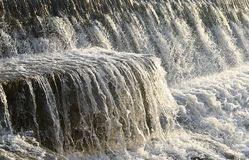 Clean Water Flowing over Stone and Sprinkles of Drops royalty free stock images