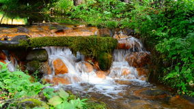 Clean water flows through the rocks stock footage