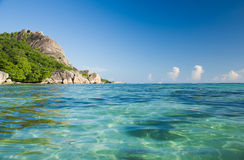 Clean water and huge granite rocks of La Digue, Seychelles. Stock Photos