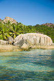 Clean water, natural pools, huge granite rocks of Seychelles. Stock Images