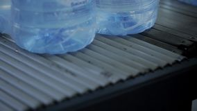 Clean water in plastic packaging is conveyed by conveyor in production. stock video footage
