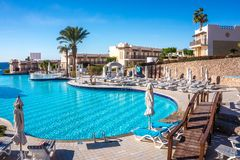 Clean water in the swimming pool and beach bar. Rest in the hotel on the Red Sea coast. Sharm El Sheikh / Egypt - November 10 2017: Clear water of a picturesque stock images