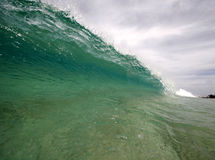 Clean wave. A wave breaking along the sea shore Royalty Free Stock Photo