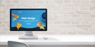 Clean web designer desk with computer display and modern flat design web site teme with web design text