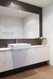 Clean white bathroom with mosaic rustic splashback Royalty Free Stock Photos