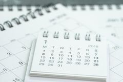 Clean white calendar business deadline, time passing, year planning or appointment reminder concept by pile of white and clean pa. Per calendars on office table stock photos