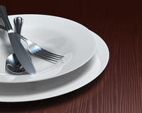 Clean white dishes & cutlery on dark woodgrain tab royalty free stock image