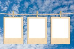 The clean white folias of paper hang on a rope Stock Photo