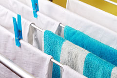 Clean white laundry pinned with blue clothespins Royalty Free Stock Photos