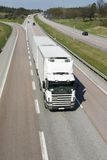 Clean, white lorry on highway. Large white lorry coming head-on on motorway stock photos