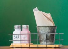 Clean white napkins with salt cellar and toothpick.  Royalty Free Stock Photography
