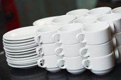Clean white plates and cups Stock Image