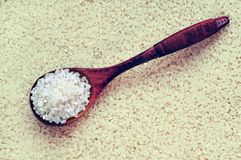 Clean white rice in a wooden spoon Stock Photography