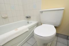 Clean white toilet and bathtub Royalty Free Stock Photo