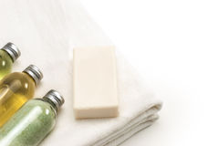Clean White Towel with Bath Lotions royalty free stock photos
