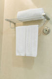 Clean white towel on a hanger prepared in bathroom . Clean white towel on a hanger prepared in bathroom Stock Image