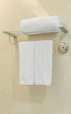 Clean white towel on a hanger prepared in bathroom . Clean white towel on a hanger prepared in bathroom Royalty Free Stock Images