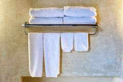 Clean white towel on a hanger prepared to use.  Royalty Free Stock Image
