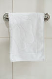 Clean white towel on a hanger. Prepared to use Royalty Free Stock Image