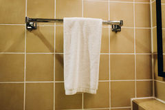 Clean white towel hanging on a hanger ready to use. Color tone effect applied Stock Photography