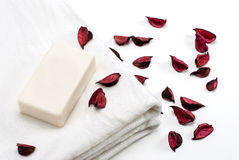 Clean White Towel with Soap and Rose Leafs Royalty Free Stock Images