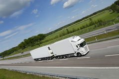 Clean white truck on highway Stock Photo