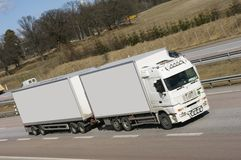 Clean, white truck, lorry. White lorry driving on motorway Stock Photos
