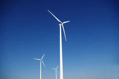 Clean wind energy. Clean energy generating wind power station Stock Photography