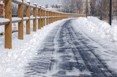 Clean winter road. A fresh cleaned from snow road,day light ,close up Royalty Free Stock Image
