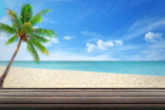 Clean wood table on beach. Clean wood table beach and palm in background Royalty Free Stock Images