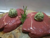 Raw rump steaks preparing with herbs and seasoning Royalty Free Stock Image