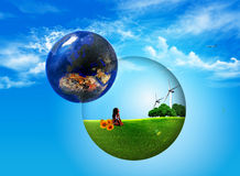 Clean world. Ball inside ptato trees and wind turbines Stock Image