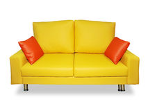 Clean yellow sofa and pillows Stock Photos