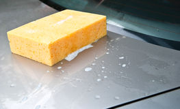 Cleaned the car with sponge Stock Photo