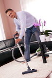He cleaned the carpet, vacuum cleaner. Stock Image