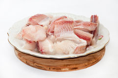 Cleaned and cut fish prepared for frying Stock Photos