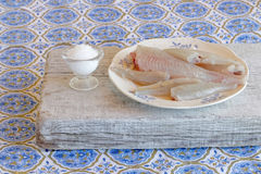 Cleaned fish on a plate Stock Image