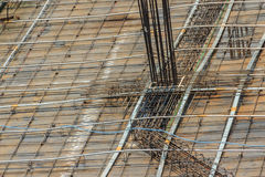 Cleaned floor slab reinforcement bar with post tension cable ten. Don on steel form work at the construction site before concreting Stock Image