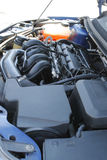 Cleaned gas engine with pipes and tubing. Engine bay under the hood with boxes, pipes, tubing and cooling vessel Stock Photos