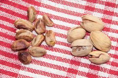 The cleaned roasted pistachios over red tablecloth Royalty Free Stock Photography